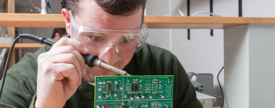 student soldering a circuit board