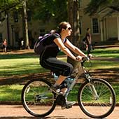 student riding a bike on the Horseshoe